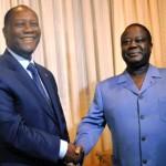 Alassane Ouattara (à gauche) et Henri Konan Bédié en novembre 2012.SIA KAMBOU / AFP